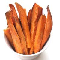 baked sweet potato fries in white bowl