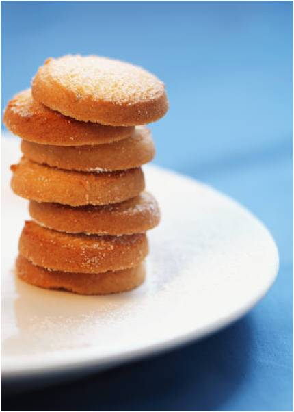ginger snap cookies stacked in a pile