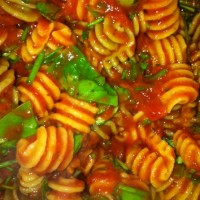 quinoa pasta with red sauce and basil