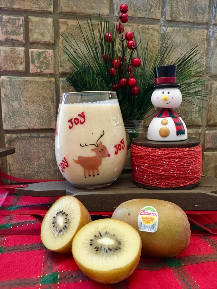 eggnog recipe image with kiwi decorated with a snowman and red holiday decor