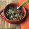 lentil salad in orange bowl on placemat
