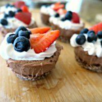 gluten free vegan chocolate cheesecake with berries on top