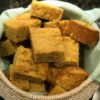 amaranth cornbread in bread basket with teal cloth
