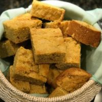 amaranth cornbread in bread basket with teal cloth