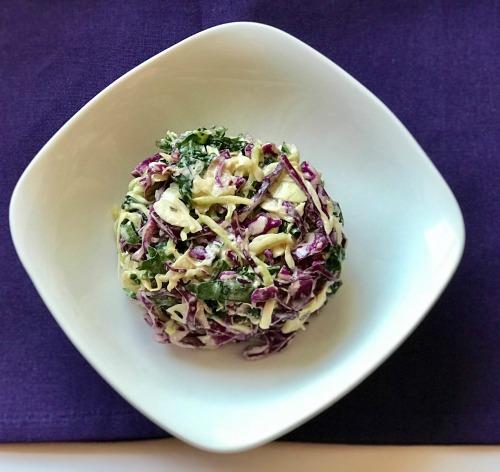 broccoli and veggie slaw in white bowl