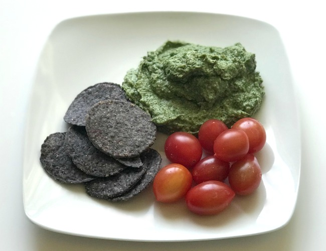 spinach artichoke dip with chips and tomatoes