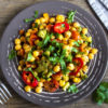 Homemade spicy vegetarian stew with chickpeas and vegetables on plate close up - healthy vegetarian food