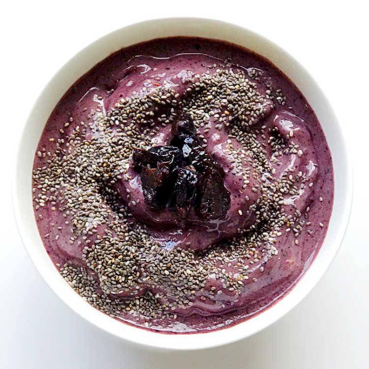 purple acai chia and dried plum smoothie bowl - ancient grain recipe - Melissashealthyliving.com
