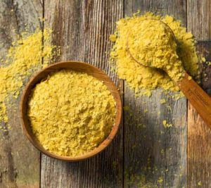 nutritional yeast in a bowl with spoon